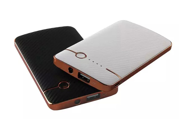 Mobile phone power bank with carbon fiber cover
